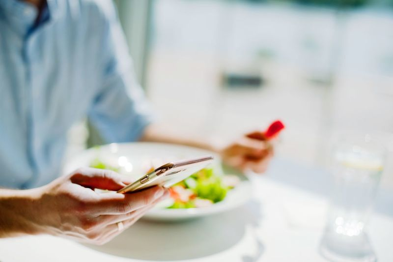 young guy eating a salad Food And Drink One Person Food Human Hand Hand Plate Holding Midsection Real People Healthy Eating Indoors  Human Body Part Freshness Eating Utensil Focus On Foreground Ready-to-eat Adult Women Kitchen Utensil Meal