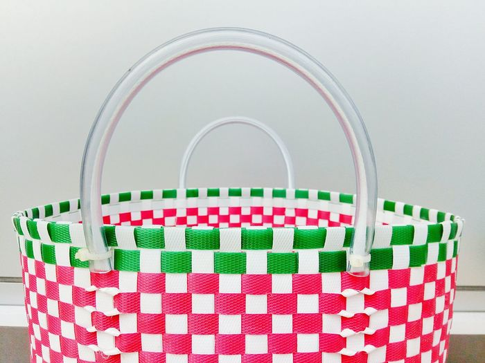 Close-Up Of Multi Colored Basket Against Wall