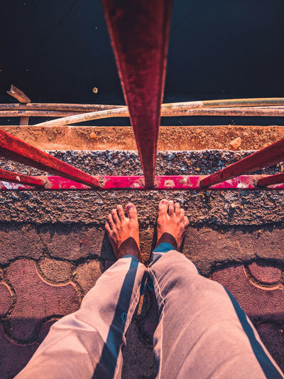 Low Section Close-up Legs Crossed At Ankle Personal Perspective Canvas Shoe Human Foot Shoelace Human Feet Footwear Human Toe Slipper  Feet Up Pedicure Sandal Pair Rolled Up Pants Things That Go Together Shoe Flip-flop Wooden Floor Human Leg Toenail