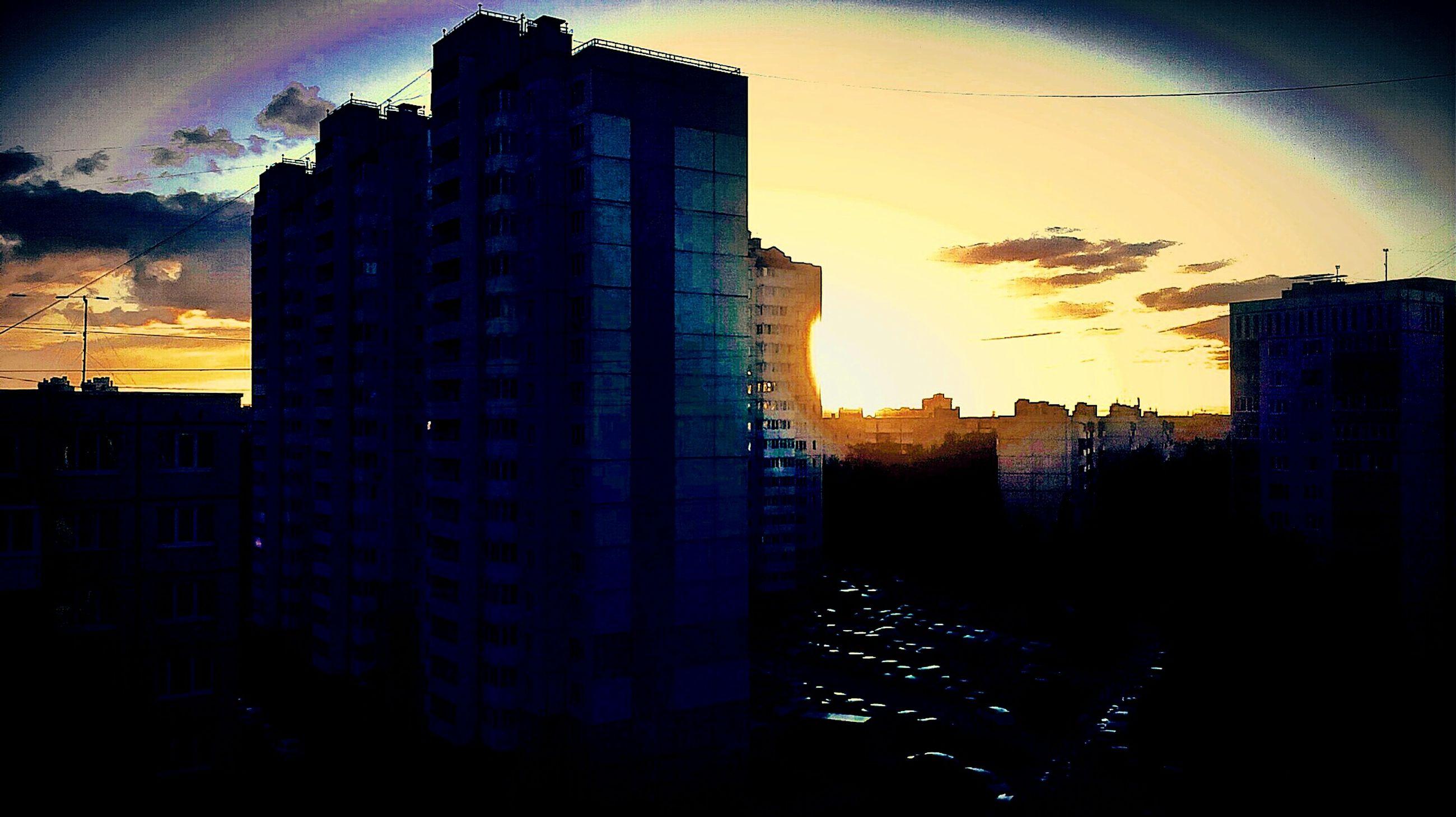 building exterior, sunset, architecture, built structure, city, sky, silhouette, cityscape, orange color, cloud - sky, building, residential building, residential structure, sun, sunlight, skyscraper, residential district, dusk, no people, outdoors