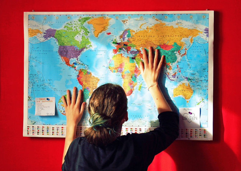 Woman looking at world map