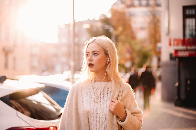 Portrait of woman standing in city