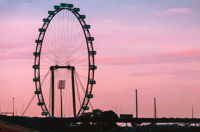 Singapore Flyer at sunset Sky Sunset Amusement Park Ride Cloud - Sky Amusement Park Ferris Wheel Nature Architecture Arts Culture And Entertainment Built Structure No People Travel Destinations Orange Color Outdoors Pink Color Silhouette Travel Dusk Illuminated Low Angle View Fairground Singapore Singapore Flyer Tourism Beautiful