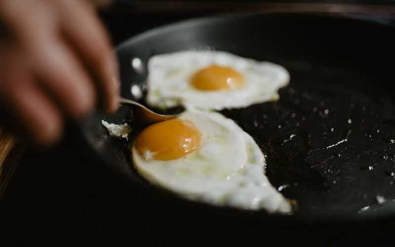 Close-up of eggs in frying pan