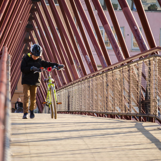 Adult Adults Only Bike Bridge Child Childhood Crossing Day Difficult Full Length Hard Helmet Life One Person Outdoors People Pushing Real People Riding Women Young Adult The Street Photographer - 2017 EyeEm Awards