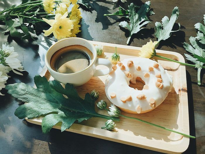 Coffe 'n a donut Leaf Plant Baked Pastry Item Appetizer No People Snack Freshness Food Sweet Food Indoors  Ready-to-eat Gourmet Table Temptation Close-up Day Coffee Coffee And Donut Black Coffee Flower Decoration Flower And Food Sweet Romantic Sunlight EyeEmNewHere