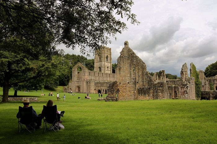 History Architecture Built Structure Old Ruin Travel Destinations Ancient Civilization The Past Building Exterior Tourism Archaeology Travel Ancient Grass Spirituality Tree Day Men Sky Outdoors Adult Fountains Abbey Yorkshire Fountains Abbey