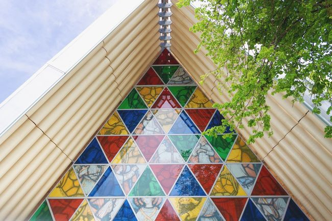 The Cardboard Cathedral Tourist Attraction  Tourism Christchurch New Zealand Church Built Structure Architecture Building Exterior Multi Colored Low Angle View No People Day Sky Building Nature Outdoors Decoration Triangle Shape Pattern Shape Design Tree Belief Religion Tower #urbanana: The Urban Playground