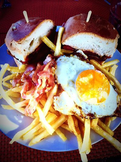 Chivito uruguaio Chivito Uruguayo Food And Drink Ready-to-eat Food Plate Freshness Indoors  No People Temptation Egg Yolk Serving Size Fried Egg Food Stories