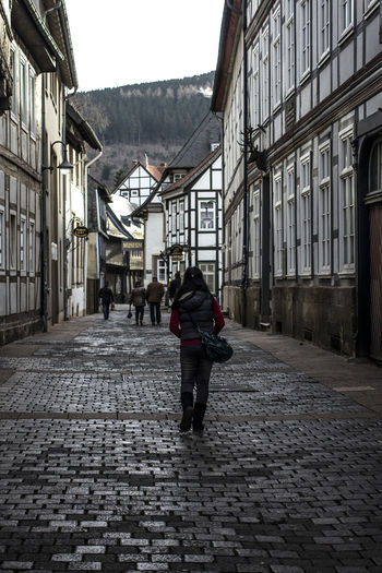 Architecture Building Exterior Built Structure Casual Clothing City City Life Cobblestone Day Full Length Germany Goslar Goslar Germany Lifestyles Men Old Town Paving Stone Person Rear View Street The Way Forward Tourism Walking Your Ticket To Europe