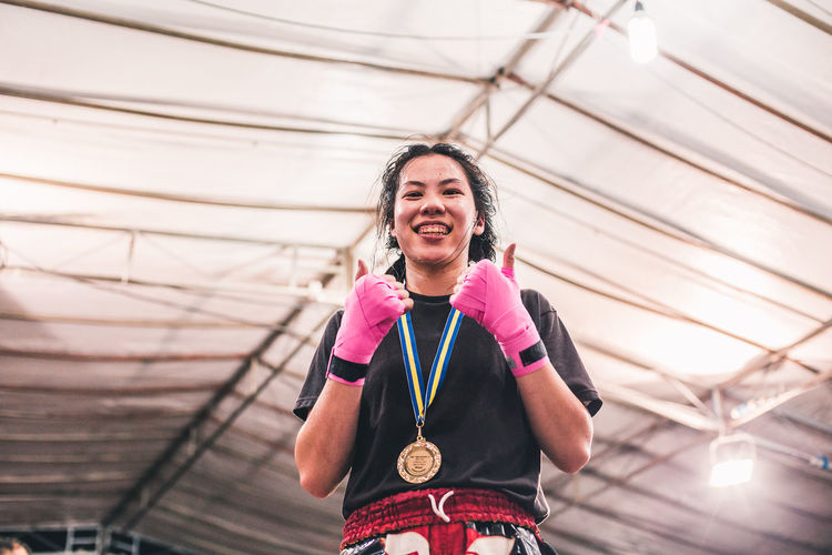Momentous. International Women's Day 2019 One Person Real People Smiling Lifestyles Happiness Emotion Females Women Portrait Young Woman Sportswoman Winner Muay Thai Fight Sport