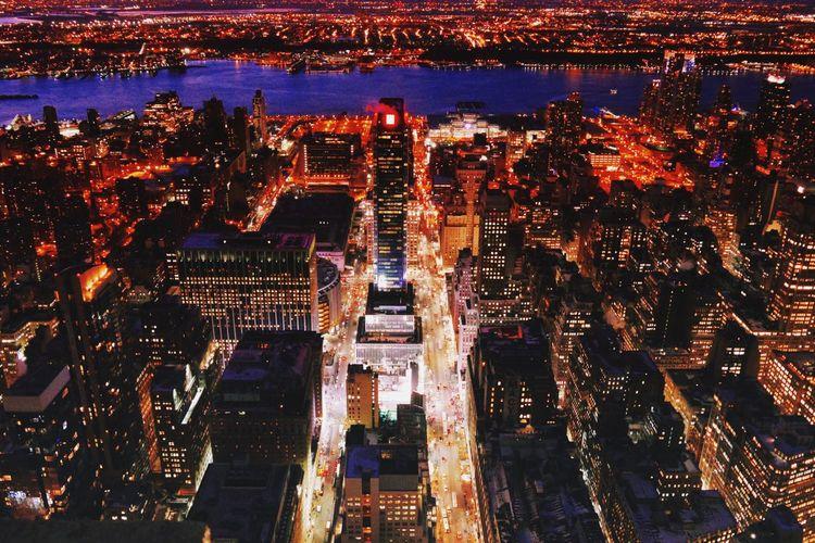 Illuminated Cityscape By Hudson River At Night