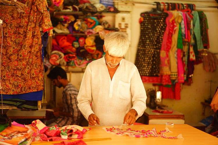 Mumbai Textiles Worker Assistant Clothes Family Business Older Man Outside Shop