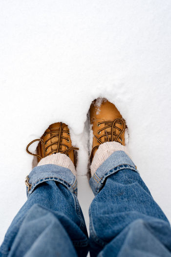 Boots in the snow, top view.