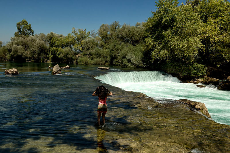 Manavgat Waterfall Flowing Water Manavgat River Manavgatşelalesi Tourist Attraction  Turkey Beauty In Nature Environment Flora Light And Shadow Manavgat Manavgat Waterfall Motion Nature One Person Outdoors River Scenery Scenics Sky Tranquil Scene Tranquility Tree Water