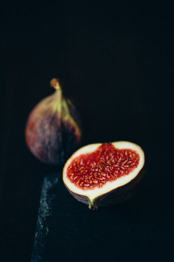 High Angle View Of Figs On Black Background