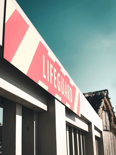 LIFEGUARD. Architecture Text Building Exterior Built Structure No People Sign Communication Western Script Red Capital Letter Low Angle View Sky