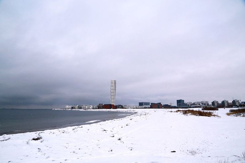 Beach In City Against Sky During Winter