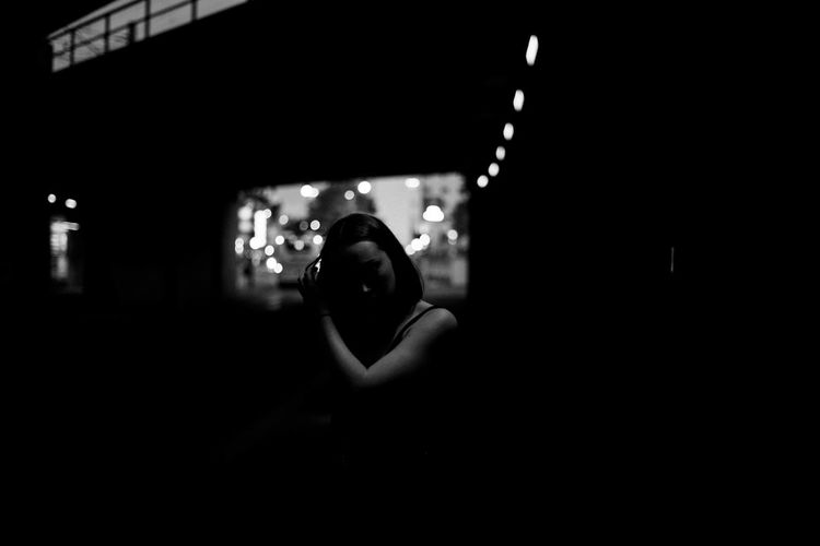 Portrait of woman photographing at night
