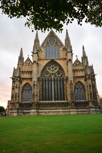 One of the oldest Lincoln Cathedral Cathedral Built Structure Architecture Building Exterior The Past Plant History Travel Destinations Building Sky Grass Religion Nature Tree Spirituality Travel Tourism Place Of Worship No People Belief Outdoors