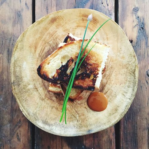 Grilled cheese sandwich on wooden table