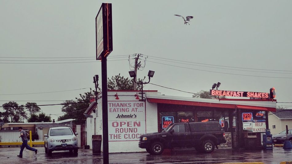 ‪Johnnie's Grill. Melrose Park, Illinois.‬ Cable Transportation Mode Of Transport Land Vehicle Power Line  Day Car Built Structure Architecture Outdoors Communication Sky Building Exterior Road Clear Sky Electricity Pylon Real People The Street Photographer - 2017 EyeEm Awards The Photojournalist - 2017 EyeEm Awards