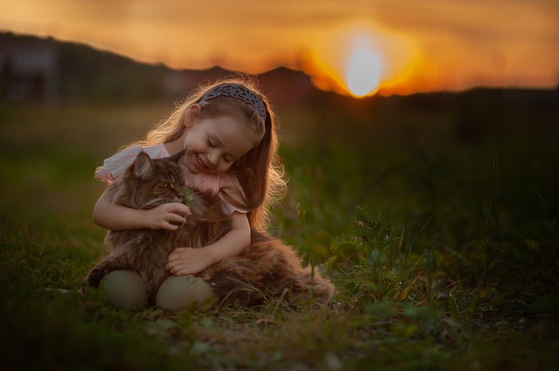 Happy curly little girl with big fluffy cat at the sunset like fairy tale Light Little Girl Cat Big Cat Tiger Photo Big Cat Sunset Sunset_collection Sun Sunrise Girl Curly Hair Curly Girl Happy Lake Lake View Fredom Cute Friendship Friends Fluffy Harmony Harmony With Nature Meadow Fairy Dreaming My Best Photo