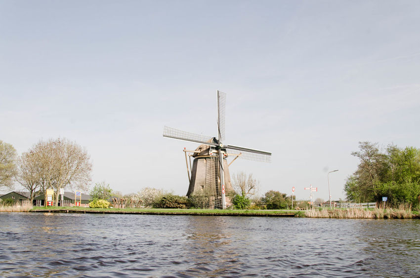 Windmill in Amstel, Amsterdam, Netherlands Amstel Amsterdam Amsterdam Canal Netherlands Architecture Boat Boatinglife Built Structure Day Environment Environmental Conservation Fuel And Power Generation Lake Nature No People Oude Kerk Outdoors Plant Renewable Energy Sky Traditional Windmill View From Boat Water Waterfront Wind Power