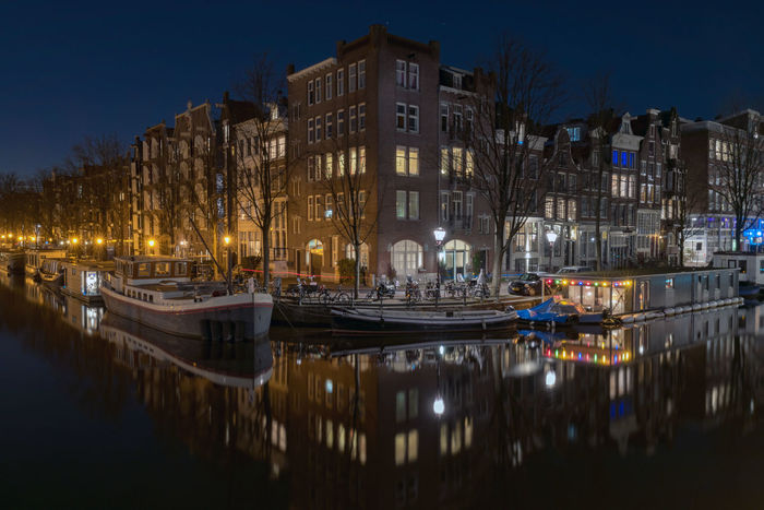 Amsterdam canal at night Amsterdam Dutch Cities Netherlands Prinsengracht Reflection UNESCO World Heritage Site Architecture Building Exterior Built Structure Canal Canals And Waterways City Dutch Herengracht Holland Illuminated Jordaan Night No People Outdoors Prinsenstraat Water Been There.