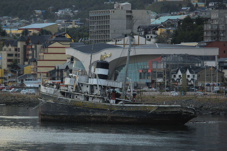 Water Transportation Nautical Vessel Architecture Built Structure Mode Of Transportation Building Exterior Waterfront City River Day Nature Building Outdoors Passenger Craft Travel No People Motion Sailboat Ushuaia Argentina Travel Destinations Aground