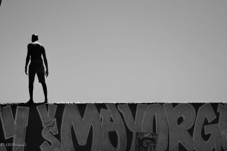 Blackandwhite Day Graffiti Graffiti Art Low Angle View Man Outdoors Silhouette Sky The Street Photographer - 2016 EyeEm Awards