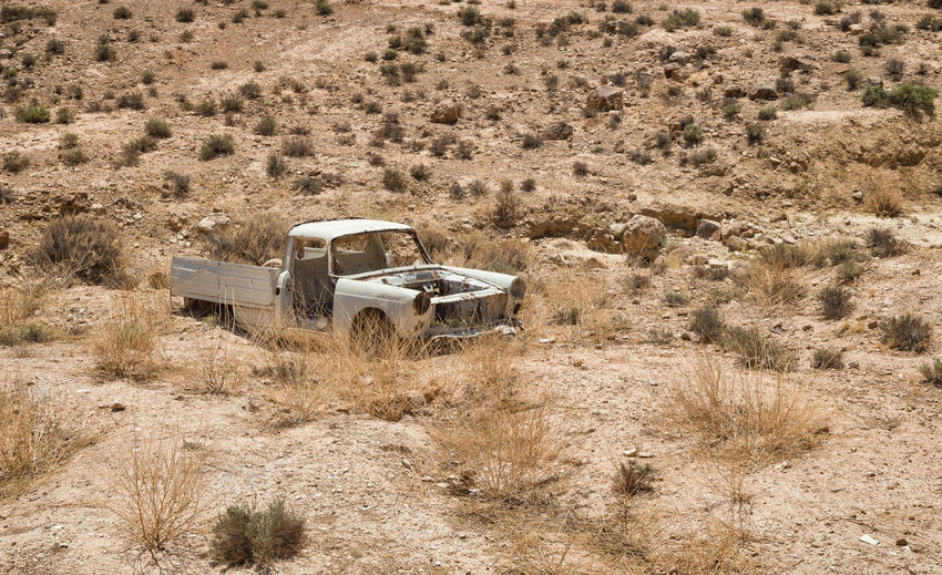 Lonely old car. Landscape Transportation Mode Of Transportation Desert Land Environment Land Vehicle Plant Day Nature Arid Climate No People Climate Semi-arid Scenics - Nature Motor Vehicle Abandoned Outdoors Non-urban Scene Field Old Car Wreck