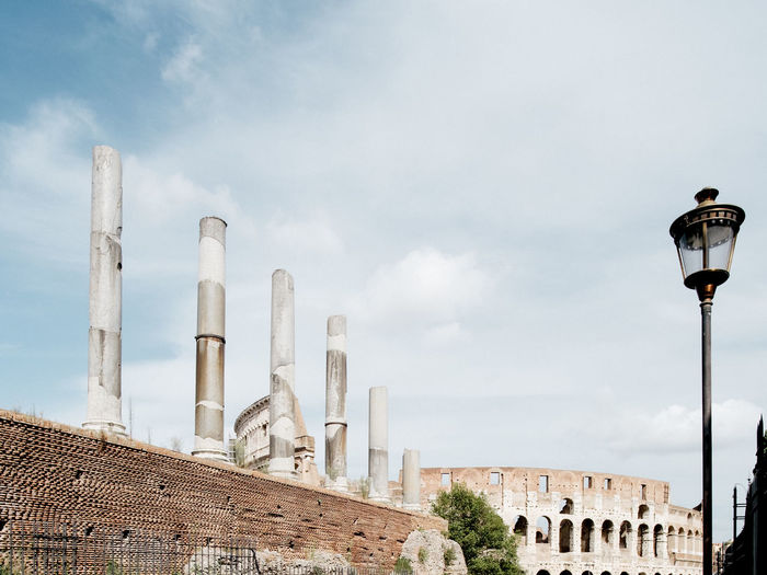 Architecture Building Building Exterior Built Structure Capital Cities  City City Life Cloud Cloud - Sky Cloudy Colosseum Day High Section Italy Low Angle View Modern No People Office Building Outdoors Rome Sky Street Light Tourism Travel Destinations Moving Around Rome