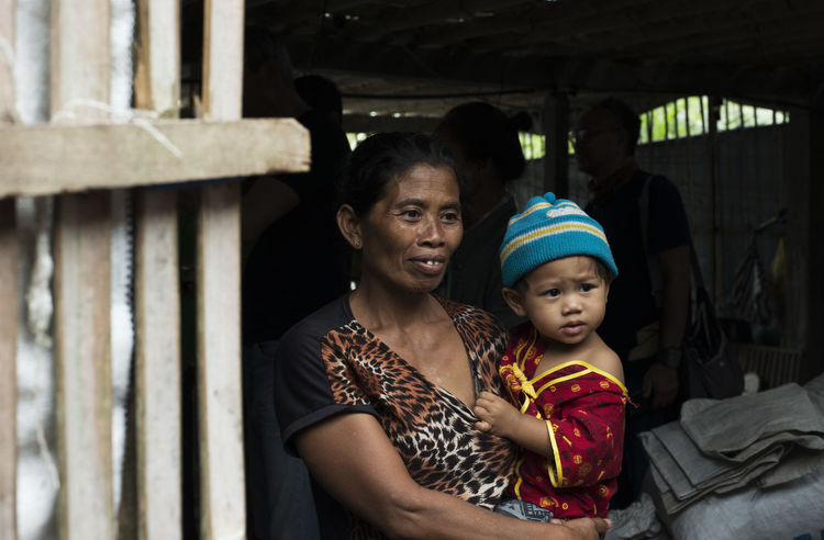 Looking for empathy and compassion near Mount Agung, Bali. At an volcano evacuation centre during the November 2017 volcano eruptions. Asian  Bali INDONESIA Mount Agung Refugee The Portraitist - 2018 EyeEm Awards Bonding Childhood Despair Emotion Evacuation Center Family With One Child Females Innocence Lifestyles Mother And Child Parent Portrait Positive Emotion Real People Shelter Son Togetherness Women