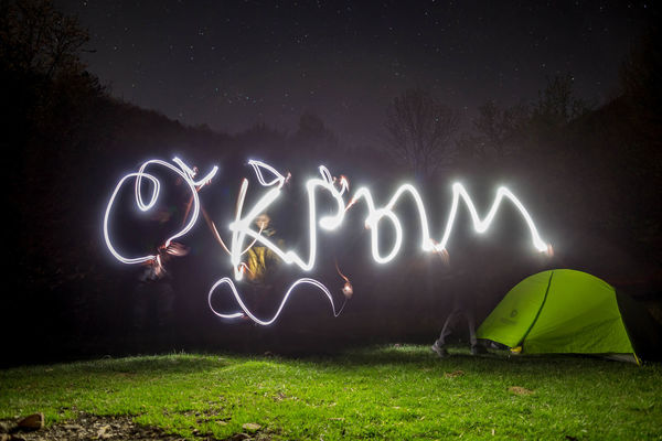 Communication Creativity Field Glowing Grass Illuminated Land Light - Natural Phenomenon Light Painting Light Trail Long Exposure Motion Nature Night No People Outdoors Plant Sign Text Western Script