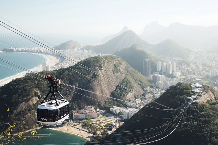 High angle view of cable car over mountains against clear sky