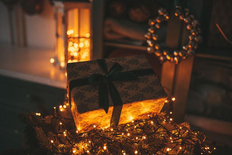 Close-up of illuminated christmas lights at home