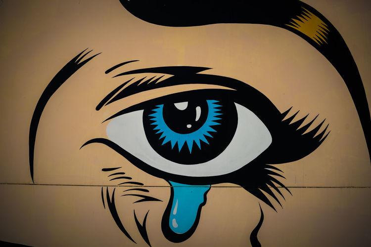 Close up of a graffiti eye in Los Angeles, USA Angry Eye Blue Eye Bright Close Up Evil Eye Eye Graffiti La Looking Los Angeles, California Stare Street Art Tear Teardrop Vibrant Vibrant Colors Wall Art Watching Watching You First Eyeem Photo Los Ángeles