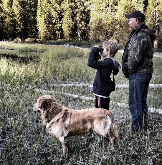 My husband, son, and one of our dogs, Cooper at Horse Lake Domestic Animals One Animal Grass Pets Dog Mammal Full Length Leisure Activity Lifestyles Togetherness Casual Clothing Side View Person Standing Tree Bonding Field Nature Growth Grassy Fatherhood Moments