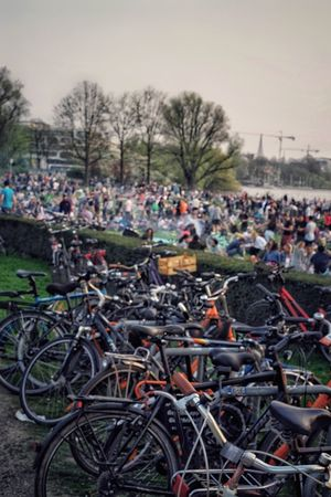 Summer People Alster Hamburg Summer Views Crowd Of People Transportation Bicycle Mode Of Transportation Land Vehicle Crowd Plant Large Group Of People Day Group Of People Real People Outdoors Men Stationary Clear Sky Field City Nature Tree Sky