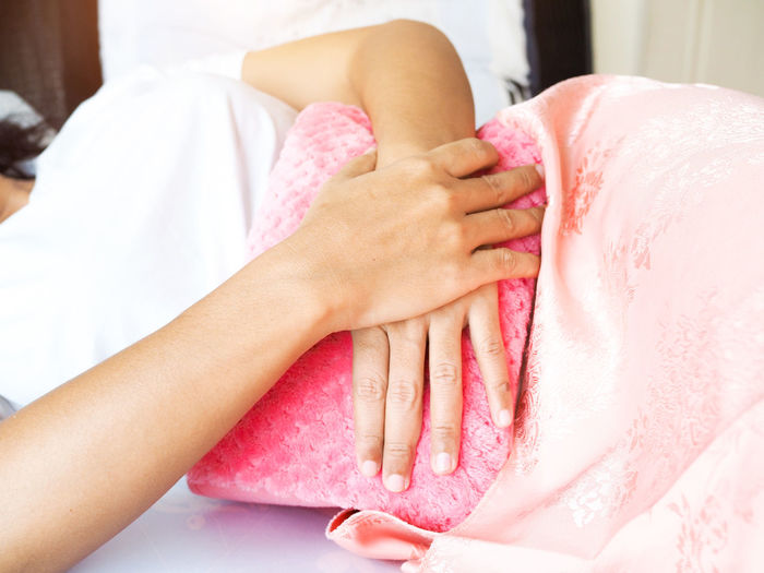 Midsection of woman holding hot water bottle