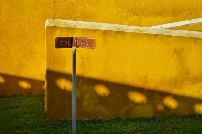 Architectural detail of cathedral in Izamal, Mexico Architecture Building Exterior Built Structure Day Grass Metal No People Outdoors Rusty Shadow Sign Stairs, Cathedral, Izamal, Mexico, Street Sign, Grass Sunlight Wall - Building Feature Yellow