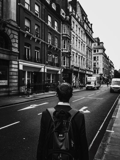 Jewish School Boy Rucksack Alone Big City Central London Street Photography Urban Exploration Architecture Fine Art Photography Eyeemphotography Road Marking One Way Arrows Pointing The Wrong Way Traffic Fine Art The Week Of Eyeem EyeEmBestPics Fresh On Eyeem  Urban Pedestrians Pavement Creativity EyeEm Best Shots