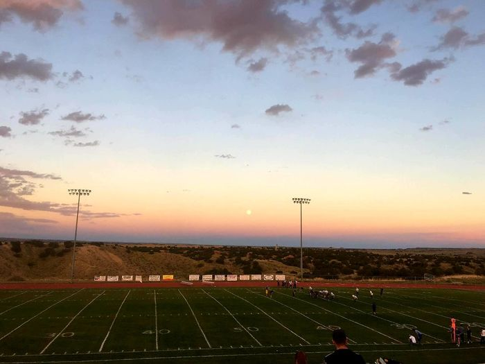 The Color Of School Field Landscape Sunset Agriculture Sky Tranquility Rural Scene The Color Of Sport Farm Wide Shot Outdoors Tranquil Scene Orange Color Scenics Nature Beauty In Nature Sun Horizon Over Land Agricultural Town High School Football Football Game Sun Setting On A Football Game High School Sports