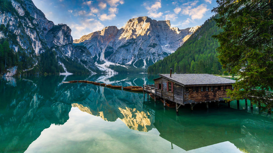Lake braies in dolomites mountains, boat hut on braies lake with seekofel mount on background