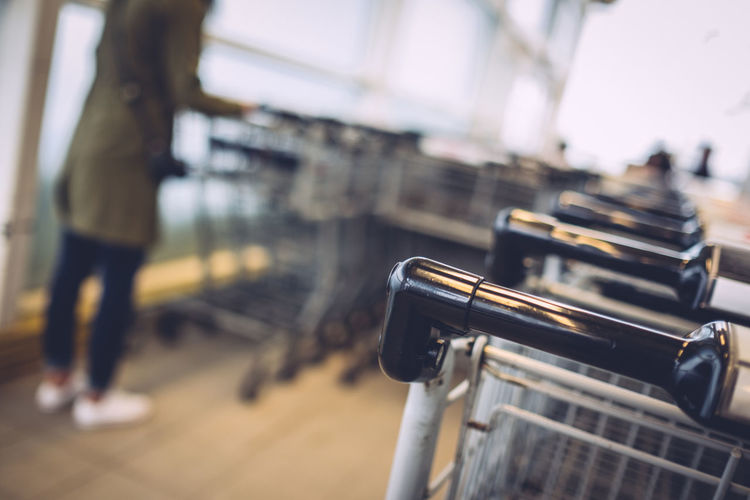 Close-up of cropped shopping trolley