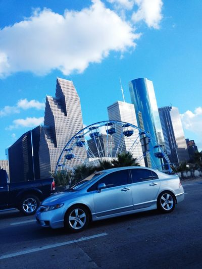 TakeoverContrast Transportation Land Vehicle Car Mode Of Transport Architecture Built Structure Building Exterior Modern Travel City Street Skyscraper Tall - High Sky Tower Sunny Outdoors Day Blue Office Building Downtown Houston Embrace Urban Life