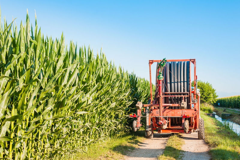 Agricultural machinery by crops on field