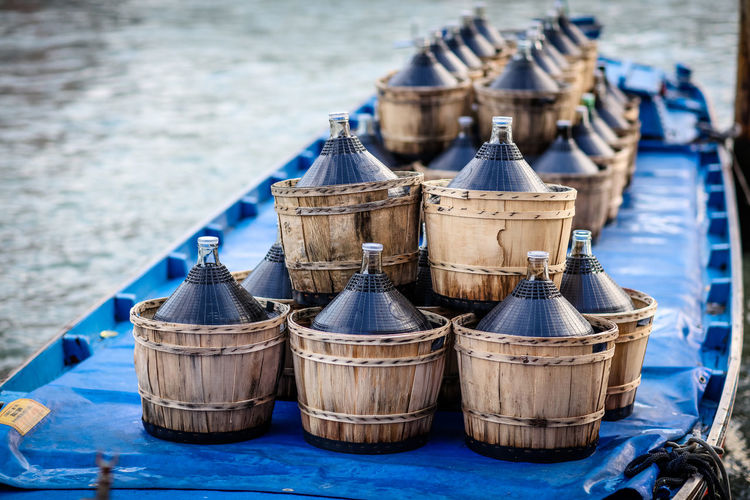 Close-up of barrels on boat in sea