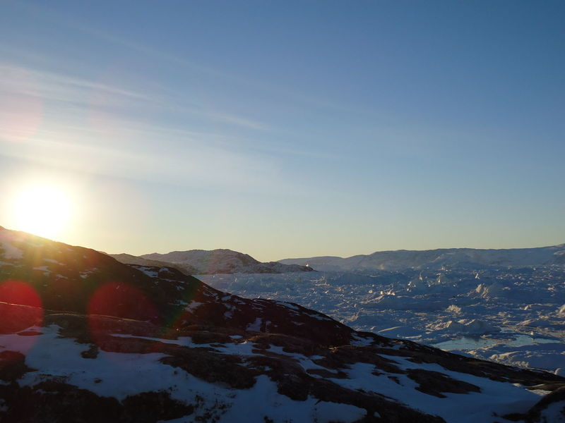 Sunset over the glacier at Ilulissat. Beauty In Nature Clear Sky Cold Temperature Day Greenland,ilulissat Landscape Mountain Mountain Range Nature No People Outdoors Scenics Sky Snow Sun Winter First Eyeem Photo